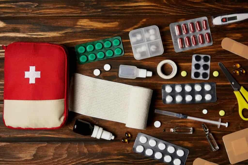First aid kit with medicine and emergency tools