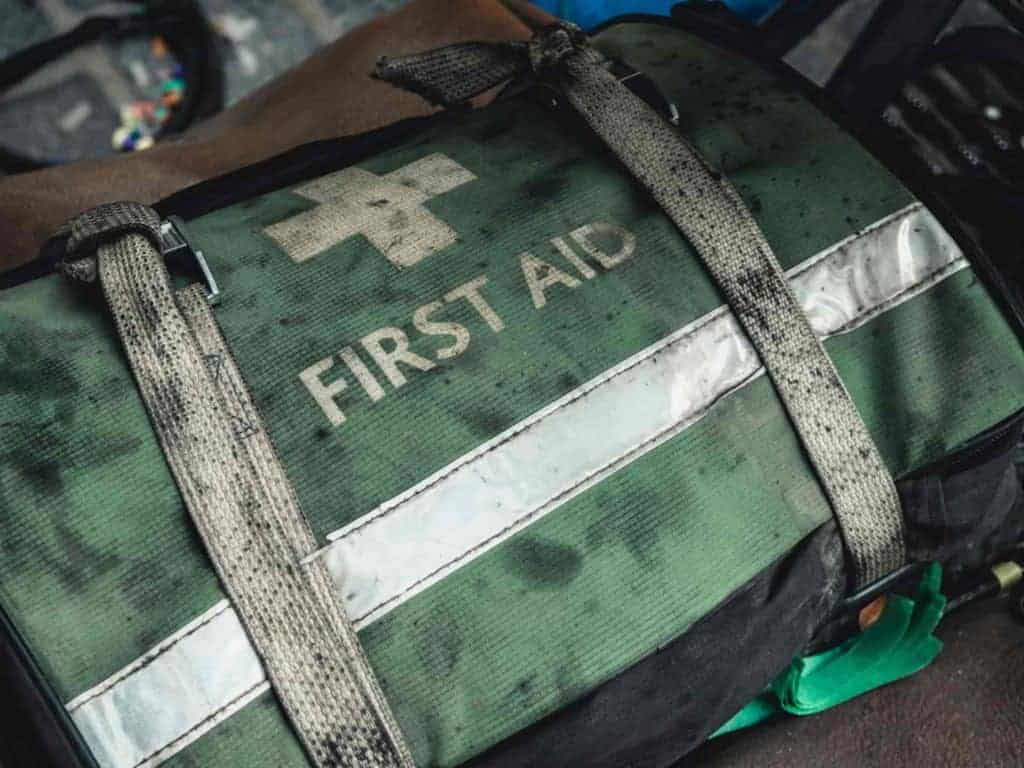 First aid survival pack with severe use marks