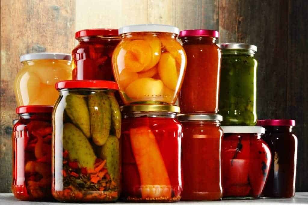 Stockpile foods with jars of pickled vegetables and fruits