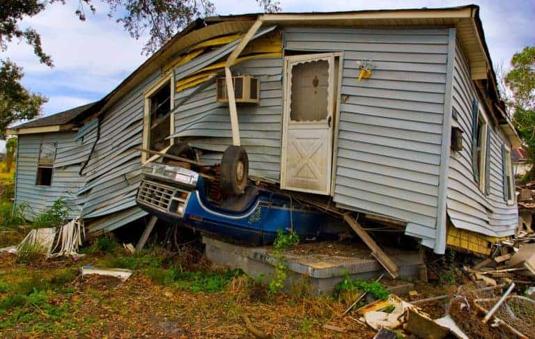 House and car severely damaged after a hurricane