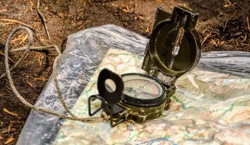 Compass over a map in the wilderness