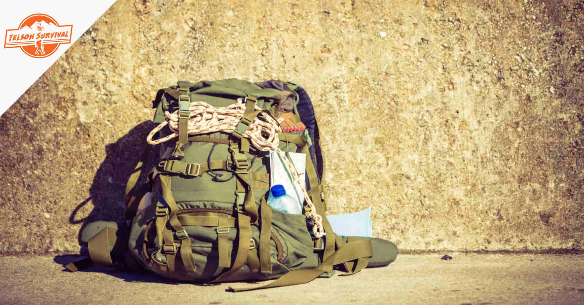 Fully equiped bug out bag next to a wall