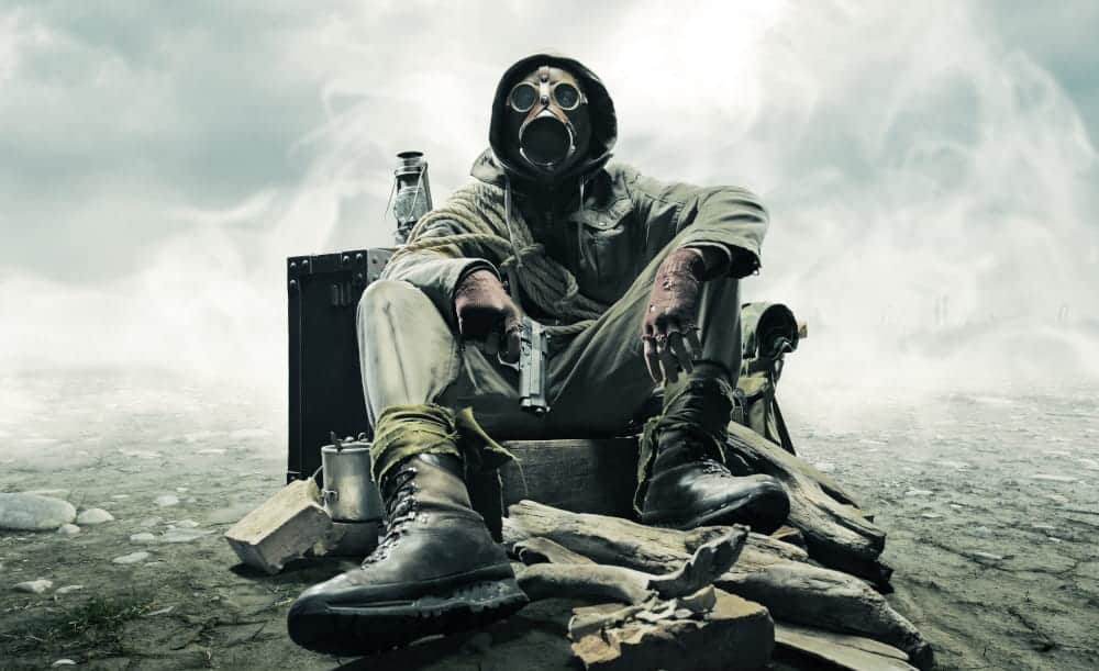 Survivor with gas mask and gun in a post apocalyptic environment