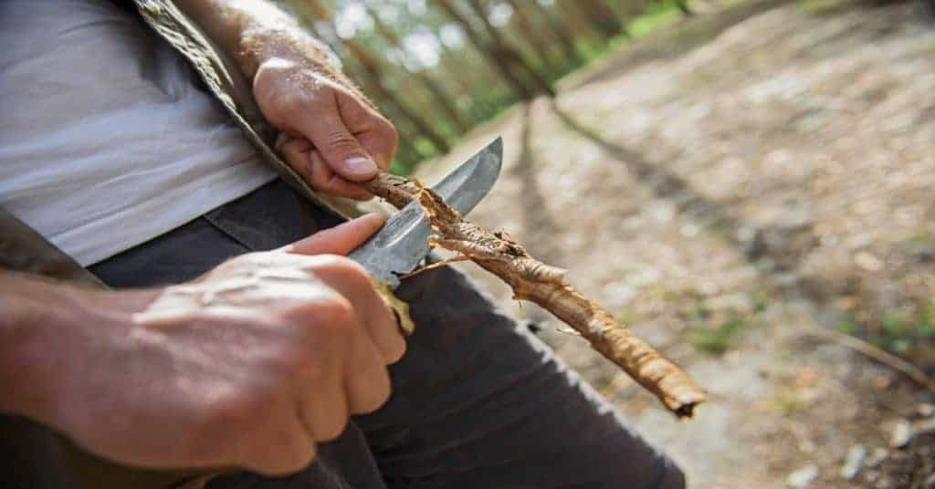 Whittling with a survival knife