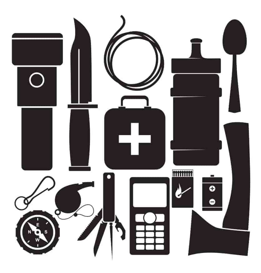 Various survival tools arranged in a kit