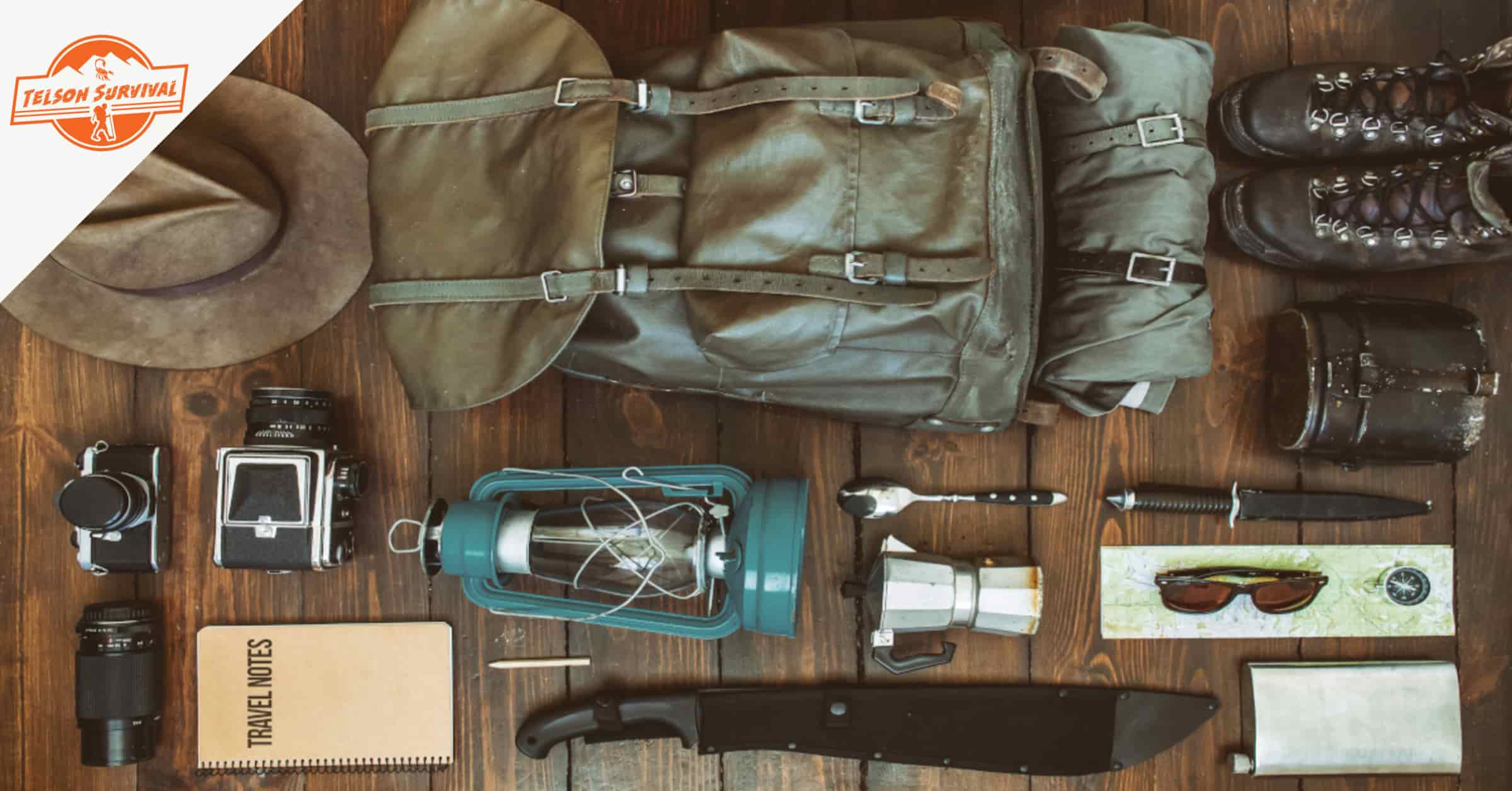 Survival gear on a table forming a wilderness survival kit