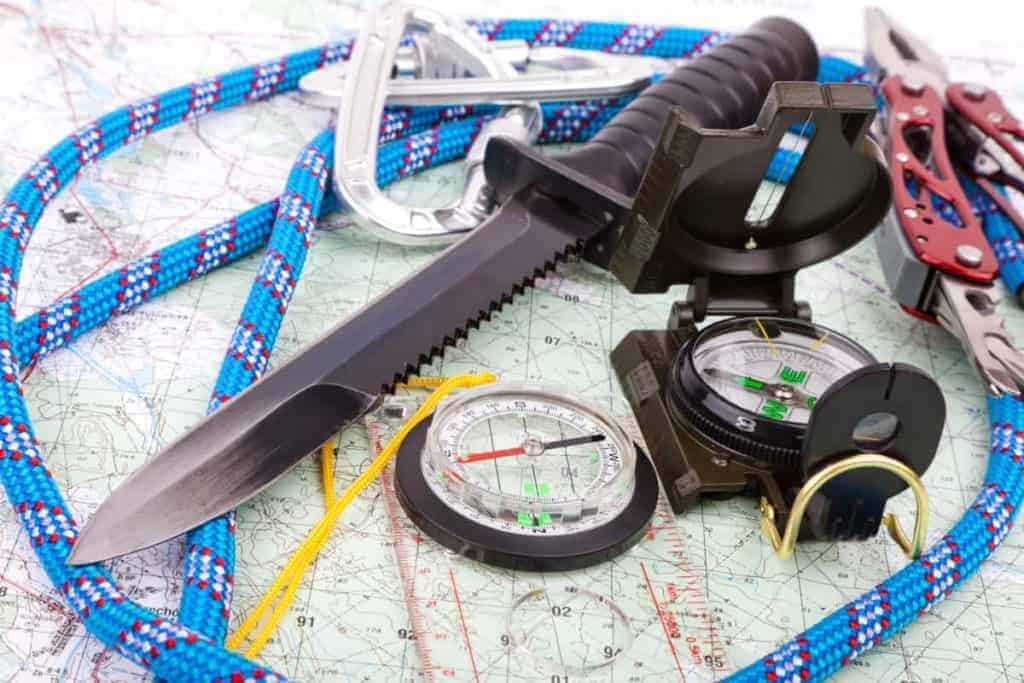 Basic survival gear: survival knife, paracord, compass, map and multitool