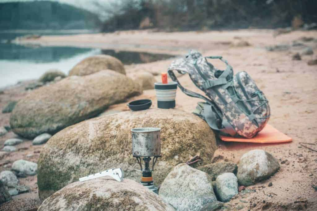 A bug out bag in the wilderness, with a portable survival stove