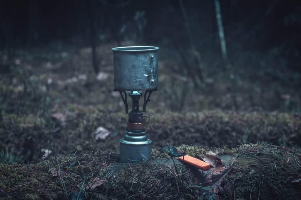 Survival stove heating food in the wilderness