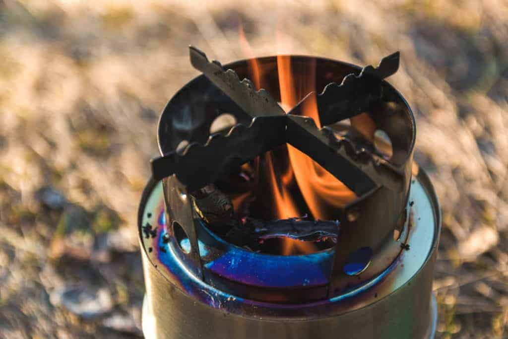 Survival rocket stove flame burning in open space