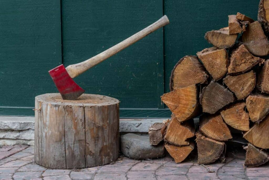 Axe and chopped wood prepared for off grid living